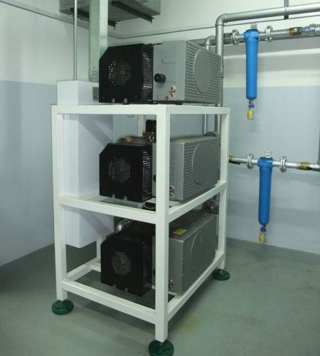Elmo Rietschle Side Channel blowers stacked on the rack in a hospital facility for ventilators