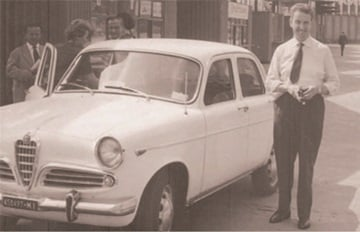 Roberto Gabbioneta, founder of Garo standing next to a car