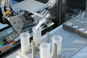 inorganic Robot with tilting glass vial with powder